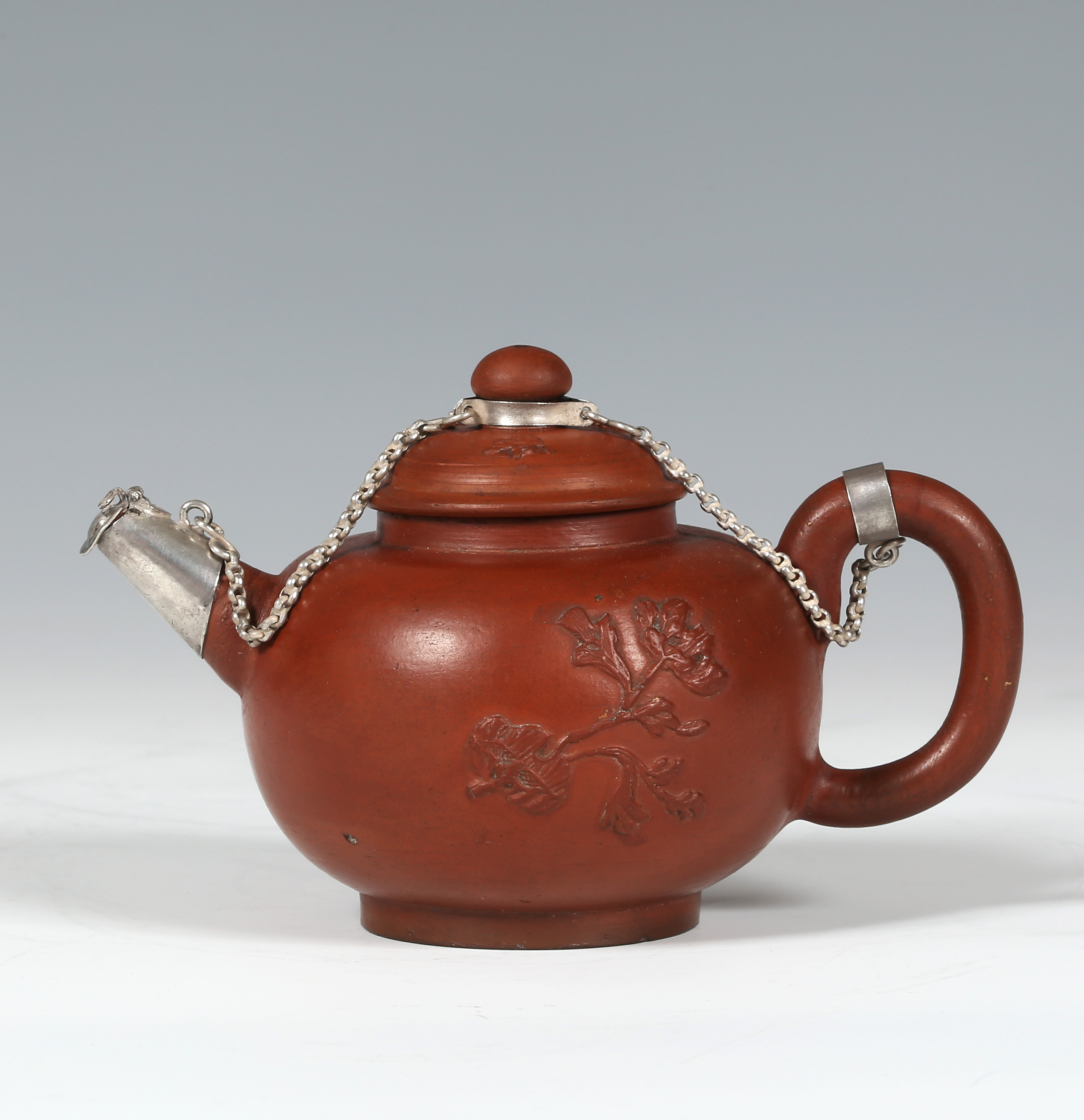 A SMALL SILVER-MOUNTED DUTCH REDWARE TEAPOT