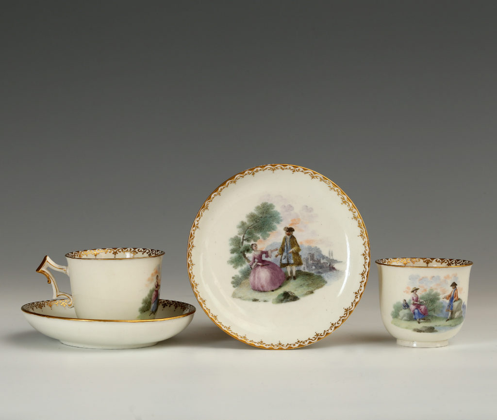 PAIR OF CAPODIMONTE CUPS AND SAUCERS