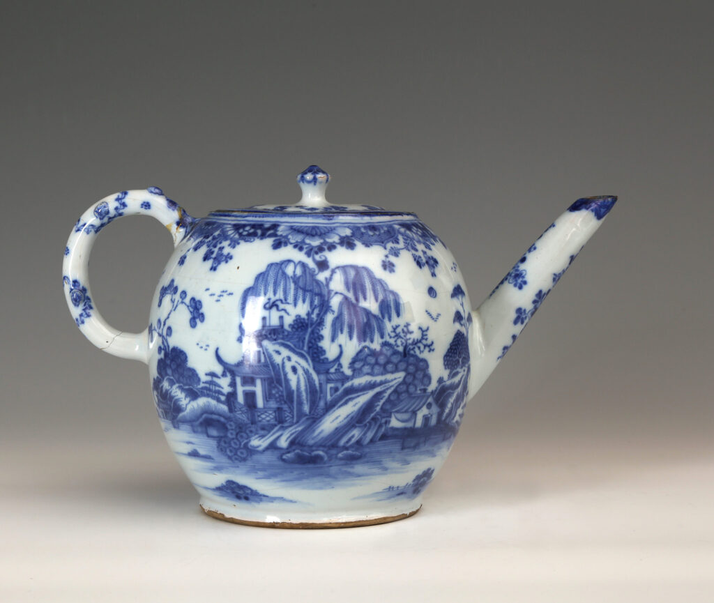 A BRITISH DELFT PUNCH POT