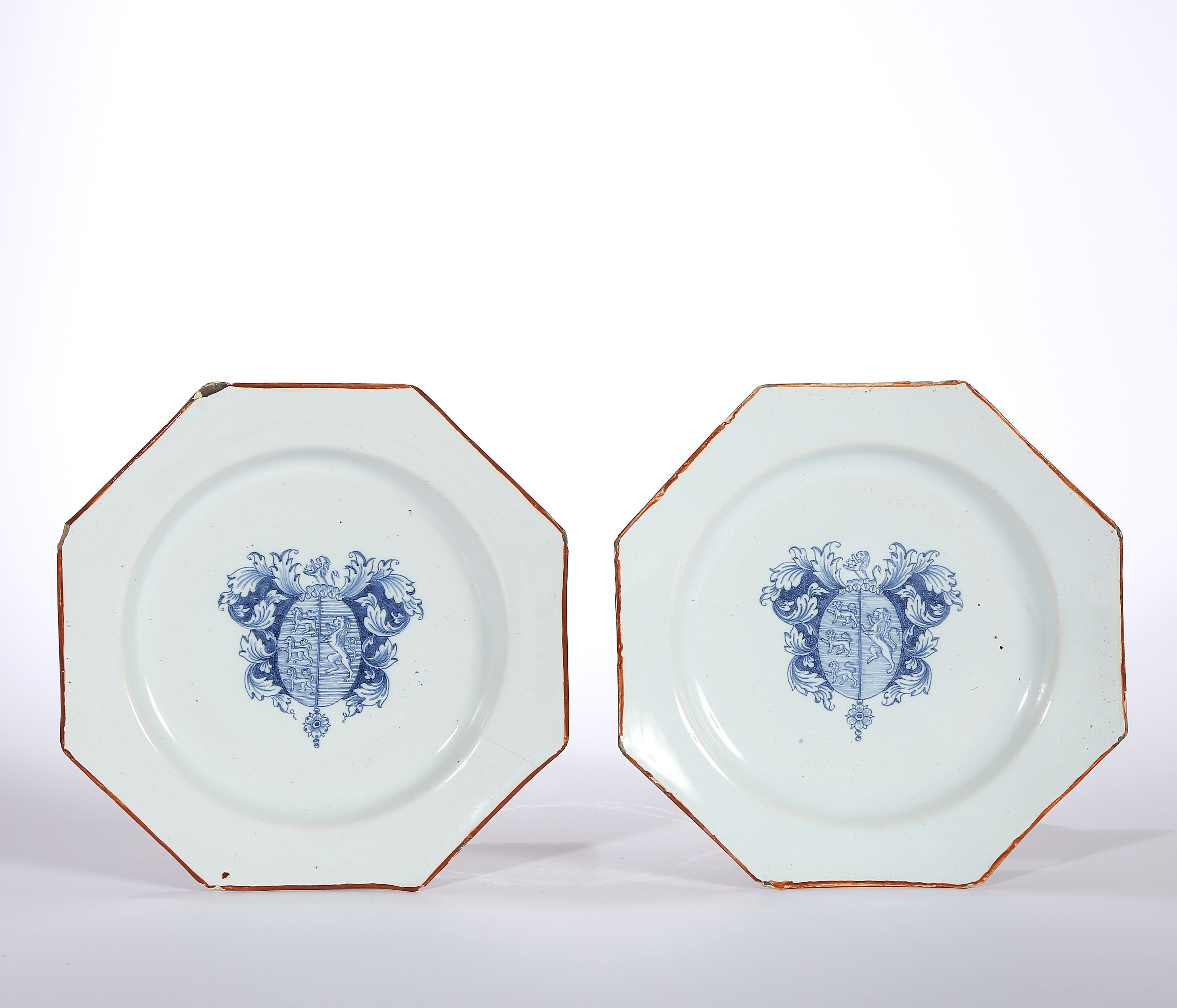 A PAIR OF ENGLISH OR IRISH ARMORIAL DELFT PLATES