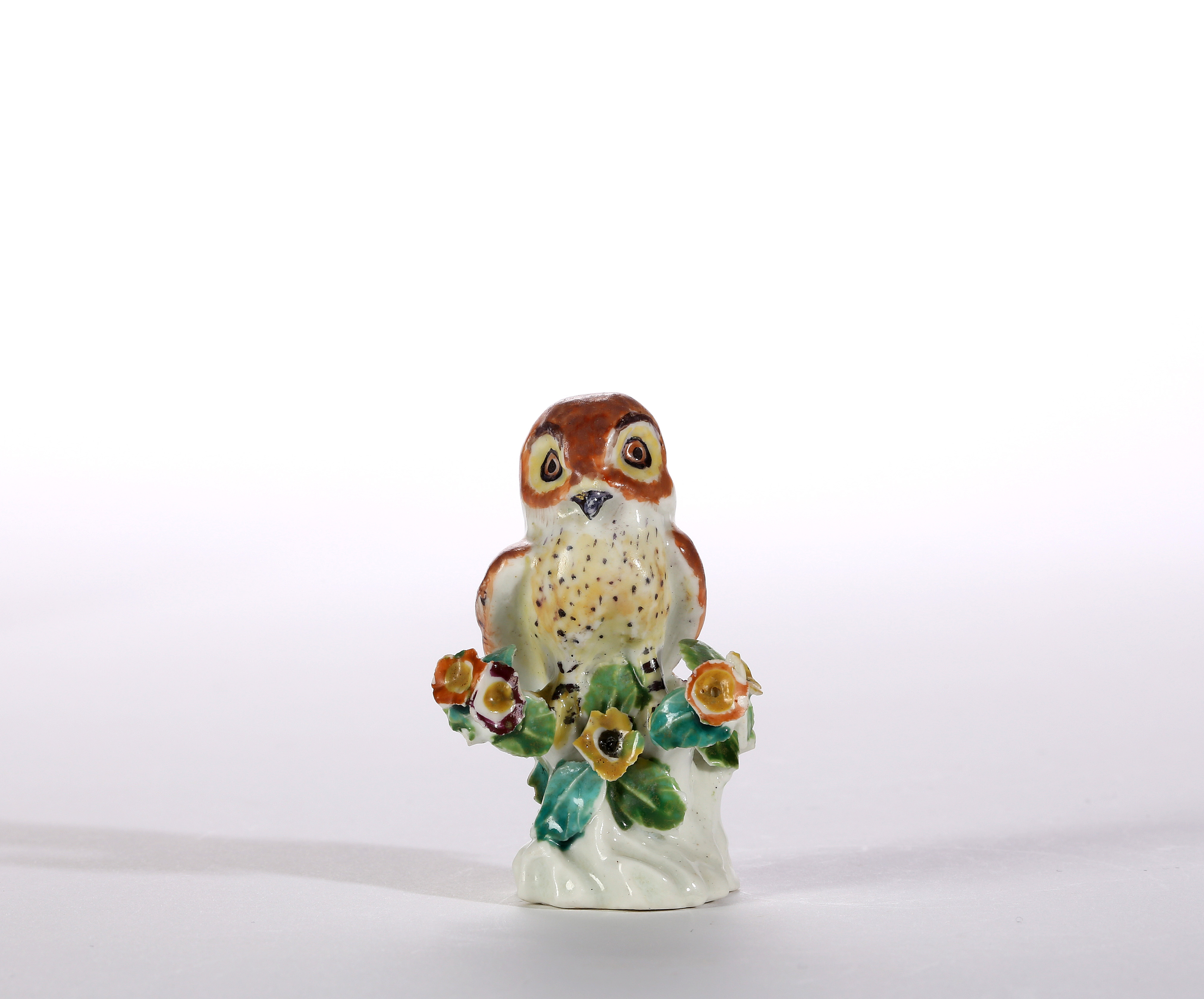 A SMALL DERBY MODEL OF AN OWL
