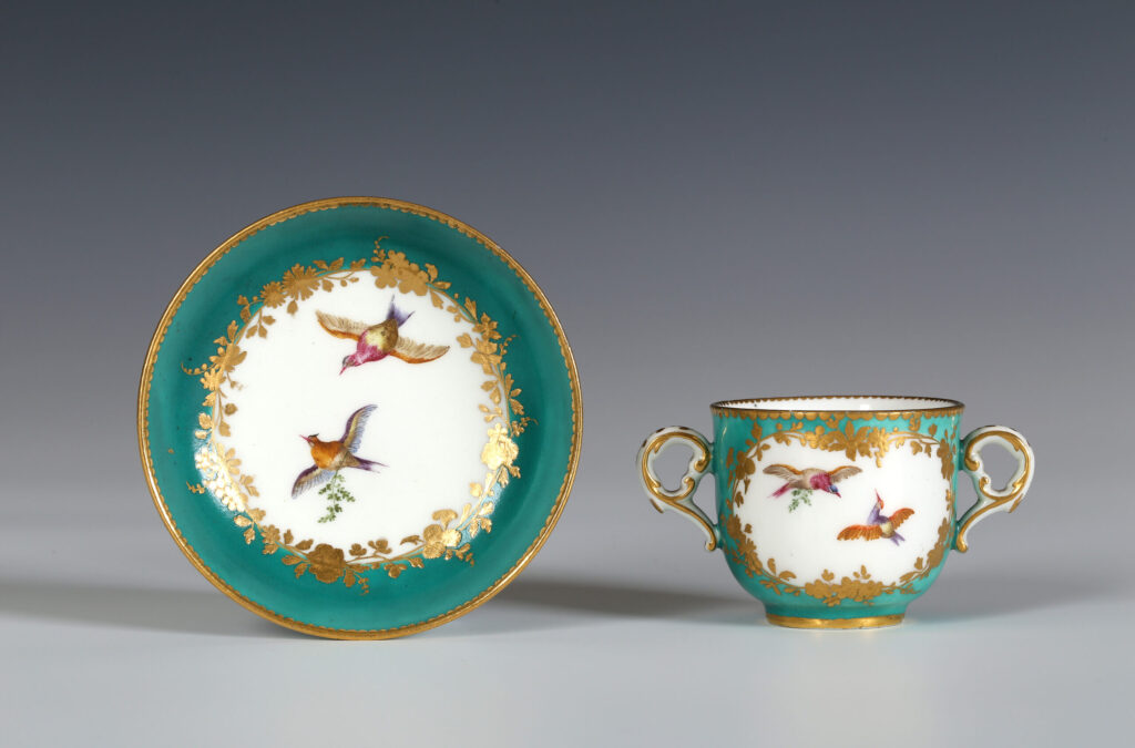 A VINCENNES GREEN-GROUND TWO-HANDLED SMALL CUP AND SAUCER (TASSE À TOILETTE ET SOUCOUPE)