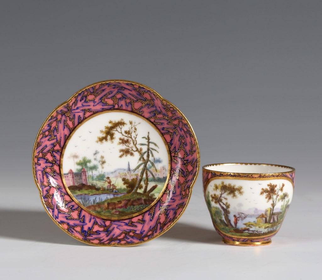 A SÈVRES ROSE MARBRÉ CUP AND SAUCER