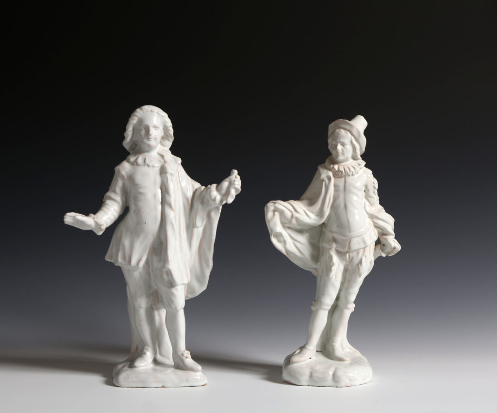 TWO STRASBOURG FAIENCE COMMEDIA DELL'ARTE FIGURES OF  MEZZETIN AND L'INDIFFÉRENT