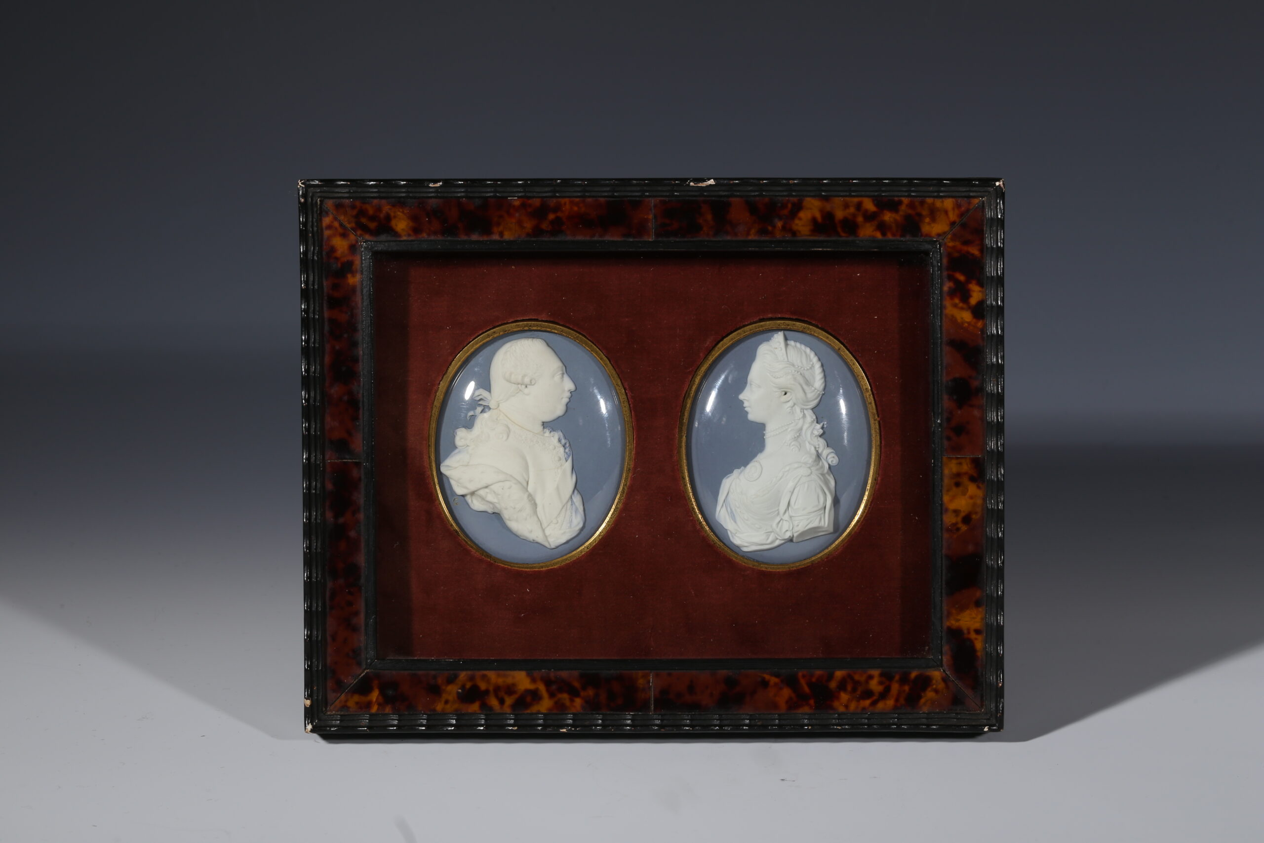 A pair of Wedgwood and Bentley medallions of George III and Queen Charlotte